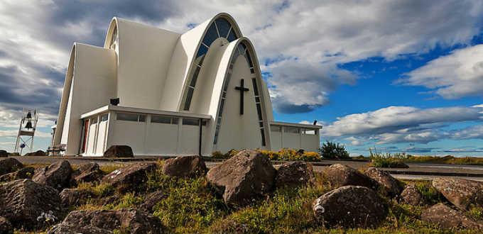 Tiny but splendid Kopavogur church is surrounded by elfstones. PIC viaggiatore Fantasma