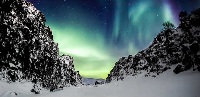 Amazing picture of Northern lights dancing above the tectonic rift in Thingvellir Iceland. PIC Arnar Valdimarsson