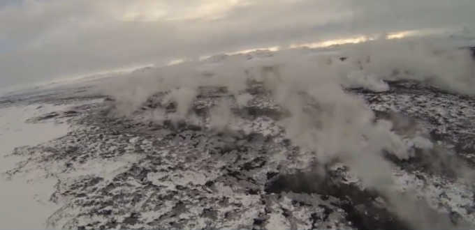 Steam rises from the rift known as Holuhraun which has spewed forth lava non-stop for eight months. PIC Norðurflug/RUV