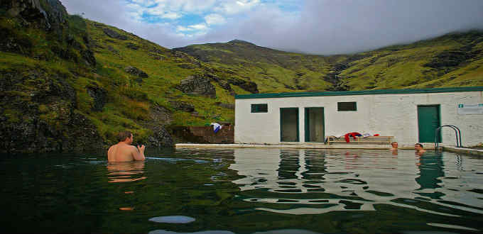Seljavallalaug pool shortly before the Eyjafjallajokull volcano. Now the place is overcrowded and dirty and the silence no golden anymore. PIC subindie