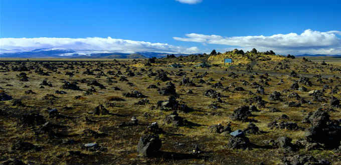 All of a sudden this little spot filled with stone cairns all over appears by the Ring Road in Iceland. PIC South.is