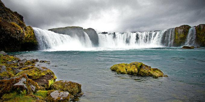 Kayaking glacial river falls in Iceland