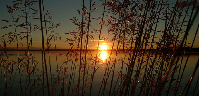 Sunset in June over the lake seen from the main campsite in the area. PIC Rusty Projector