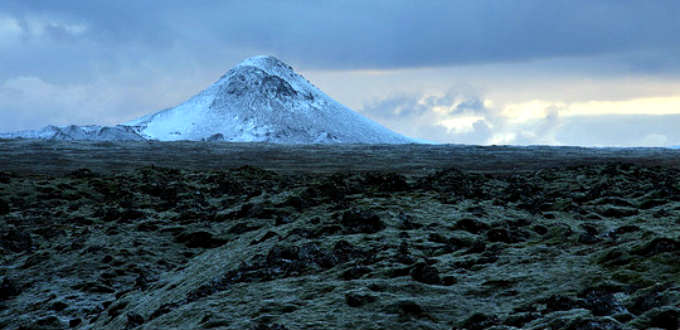 Close to the Blue lagoon in Iceland, two beckoning mountains